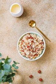 150 gr. de yogur desnatado con 40 gr. de cereales muesli